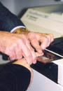 Employment applicant being fingerprinted.
