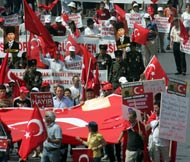 Hundreds of people demonstrate in the streets of Istanbul, Turkey on June 23,  2007 to protest against the bombings that hit the country. AFP Photo.