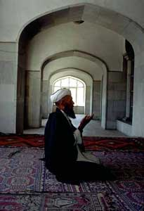 Man praying in a mosque in Kabul; UN/DPI Photo