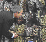 President George W. Bush greets a member of the Uganda Watoto Childrens Choir after a performance in Entebbe, Uganda on July 11, 2003. [photo: Charles Dharapak, AP/WWP]