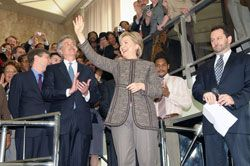 Date: 01/22/2009 Description: 67th Secretary of State Hillary Clinton arrives for her first day at the Department of State greeted by an overflowing lobby of  Department employees in the diplomatic entrance. State Dept Photo