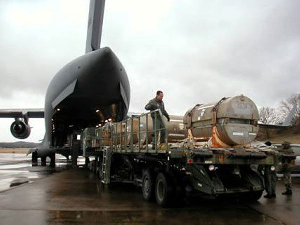 Libyan nuclear material being loaded on a C-17 cargo aircraft for disposition in the United States.