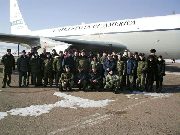 A U.S. crew flying under the Open Skies Treaty over Russia pose next to their OC-135B aircraft, in Ulan-Ude, Russia, 3 March 2006.