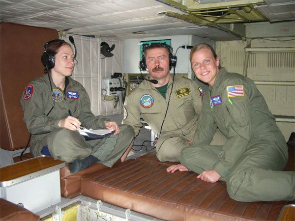 Russian and U.S. crew members monitor equipment on board a Russian Tu-154 aircraft during an observation flight over the United States, 19 April 2006, under the Open Skies Treaty.