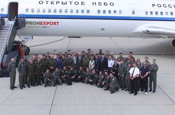 Members of a Russian crew pose on the tarmac next to a Tu-154 aircraft together with their U.S. counterparts during an observation flight over the territory of the United States under the open Skies Treaty, July 2000.