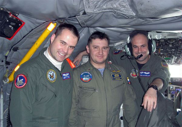 U.S. and Russian servicemen on board a plane before a joint Russian-Swedish flight over the territory of the United Sates, under the Open Skies Treaty, 2 March 2008. The Treaty establishes a regime of unarmed aerial observation flights.