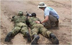 Date: 2011 Description: ACOTA trainers conducting marksmanship instruction. - State Dept Image