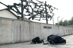 Date: 07/20/2011 Description: Imams praying spontaneously during a tour of Dachau - State Dept Image