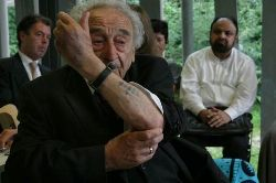 Date: 11/08/2011 Description: Imams listening to a Holocaust survivor recount his experiences - State Dept Image