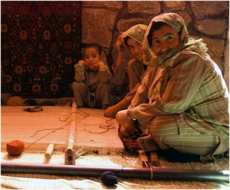 Date: 2011 Description: Recovering addicts learn carpet weaving in Herat province. - State Dept Image