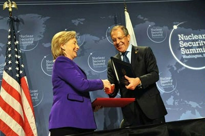 Secretary Clinton signs the Plutonium Disposition Protocol with Russian Foreign Minister Sergey Lavrov.