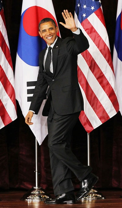 President Obama waves to the audience before a special speech at the Hankuk University of Foreign Studies ahead of the 2012 Seoul Nuclear Security Summit.