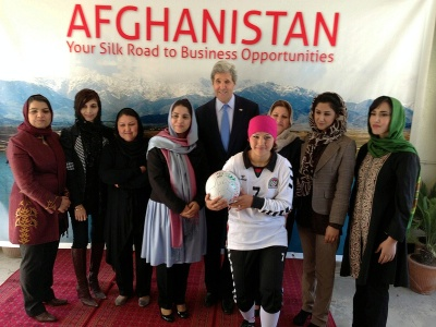 Secretary Kerry poses for a group photo during a tour of local businesses in Kabul, Afghanistan.
