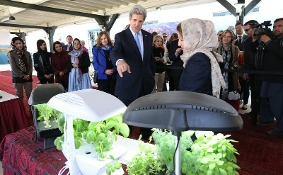 Hassina Syed, owner of the Syed Companies, explains one of her product lines, hydroponic plants, to Secretary John Kerry during a women's business showcase held at the U.S. Embassy on Tuesday, in Kabul. Her other business lines also include trucking, solar lighting and hospitality.