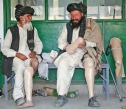 Date: 2012 Description: Two disabled men are fitted with prosthetics at an orthopedic center in Kabul, Afghanistan.  © Photo courtesy of Akmal Dawi/IRIN