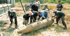 Date: 2012 Description: A Golden West Humanitarian Foundation team in Cambodia moves a 2,000 pound bomb, which was later destroyed.  © Photo courtesy of Golden West Humanitarian Foundation