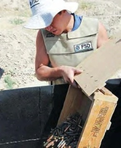 Date: 2012 Description: FSD staff in Tajikistan place shells in an incinerator to be destroyed.  © Photo courtesy of FSD
