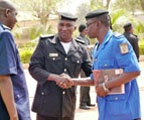 Date: 02/10/2014 Description: West African Officers shake hands - State Dept Image