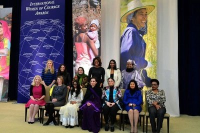 First Lady Michelle Obama, Deputy Secretary Heather Higginbottom, and U.S. Ambassador-at-Large for Global Women's Issues Catherine Russell pose for a photo with the 2014 Secretary of State's International Women of Courage Awardees at the U.S. Department of State in Washington, D.C., on March 4, 2014. [State Department photo/ Public Domain]