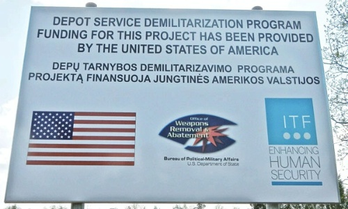 Date: 10/02/2014 Location: Lithuania Description: Sign erected near a renovated ammunition demilitarization facility © Photo courtesy of John Stevens, U.S. State Dept Image
