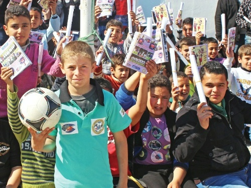 Date: 10/02/2014 Location: Jordan Description: Syrian refugees in Irbid, Jordan with soccer ball © Photo courtesy Spirit of Soccer