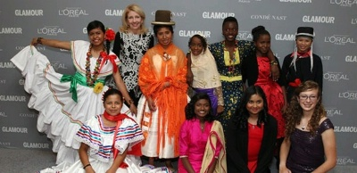 Ambassador Cathy Russell poses with girls honored at Glamour's Women of the Year ceremony at Carnegie Hall in New York.