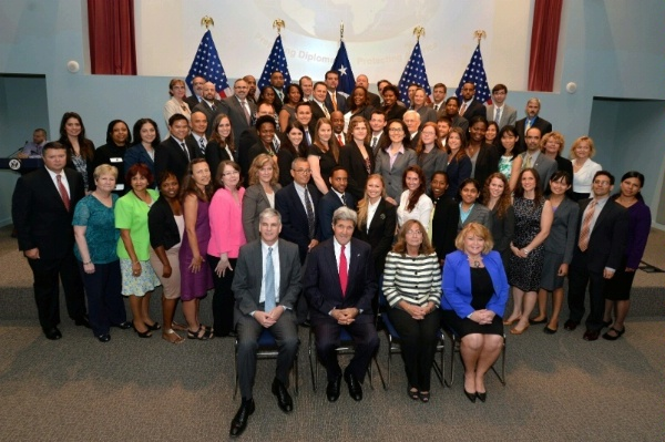 QDDR Theme: Investing in a Skilled, Diverse Workforce. Secretary Kerry presides over new Civil Service officers' swearing-in ceremony in July 2014. The class' diversity is representative of the State Department's workforce diversity.