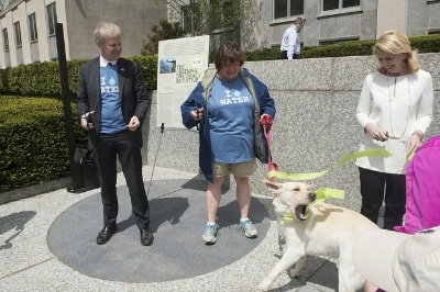 Ambassador of Sweden to the United States Björn Lyrvall,  Under Secretary of State for Economic Growth, Energy, and the Environment Catherine Novelli, and  Ambassador-at-Large for Global Women's Issues Catherine Russell are joined by Secretary Kerry's dog Ben during a ribbon-cutting ceremony at the U.S. Department of State's fifth Annual 6k Walk for Water.