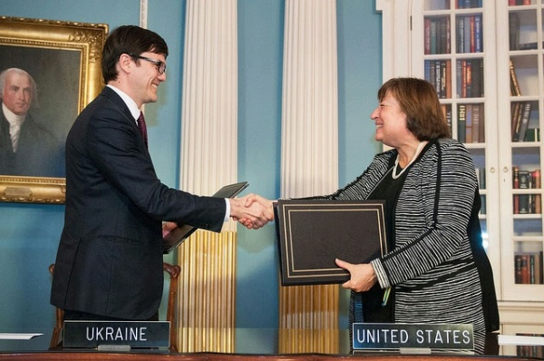 Under Secretary Novelli and Ukrainian Infrastructure Minister Andriy Pyvovarsky shake hands after signing an Open Skies Agreement between the United States and Ukraine that will promote increased travel and trade, enhance productivity, and spur high-quality job opportunities and economic growth, at the U.S. Department of State.