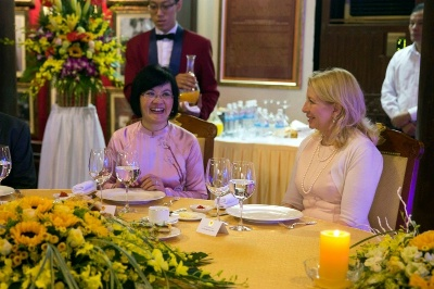 U.S. Ambassador for Global Women's Issues Cathy Russell talks with Ambassador Nga, from the Vietnam Foreign Ministry, during a tea hosted by Madam Mai Thi Hanh, First Lady of Vietnam, at the Temple of Literature, in Hanoi, Vietnam, July 20, 2015. (Official White House Photo by David Lienemann)