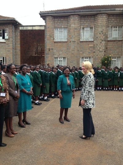 U.S. Ambassador for Global Women's Issues Cathy Russell is greeted by faculty and students at the Alliance Girls' High School in Kenya, July 23, 2015.