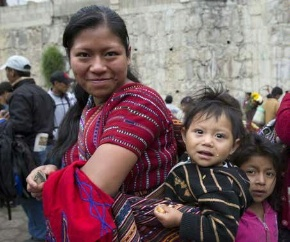 Date: 12/21/2015 Description: Maya Indian woman with baby in Lake Atitlan, Guatemala, Central America. © Papa Bravo for Shuttersotck.com