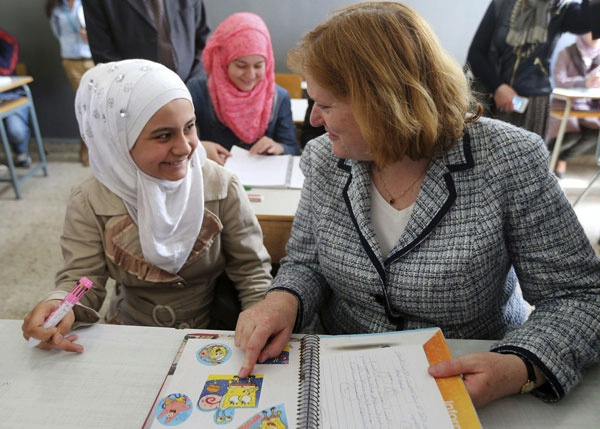 Assistant Secretary for Population, Refugees, and Migration Anne C. Richard visits refugee children at the Sed El Boucherieh Intermediate School for Girls. (April 2015)