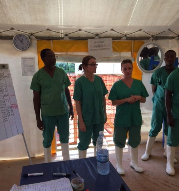 Under Secretary for Civilian Security, Democracy, and Human Rights Sarah Sewall visits an Ebola treatment center in N'Zerekore, Guinea. (April 2016) )