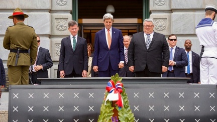 Secretary Kerry, flanked by New Zealand Attorney-General Christopher Finlayson and Defense Secretary Gerry Brownlee, pauses for a moment of silence after laying a frond at the Tomb of the Unknown Warrior at the Pukeahu National War Memorial Park at Anzac Square in Wellington, New Zealand.