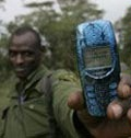 Date: 2010 Description: A ranger uses text messages to track elephants at Ol Pejeta conservancy in Kenya. © AP Image