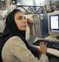 Date: 2010 Description:  A woman at an internet cafe in Iran.  © AP Image