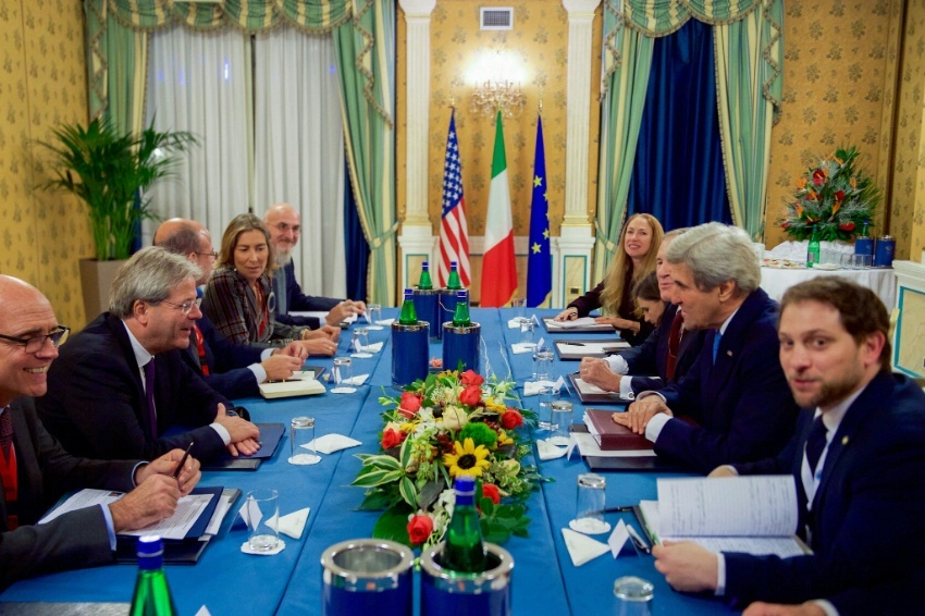 Secretary Kerry sits with Italian Foreign Minister Paolo Gentiloni to discuss Mediterranean issues on December 2, 2016, before a bilateral meeting following an Italian-hosted multinational conference about Mediterranean issues at the Parco dei Principe Hotel in Rome, Italy.