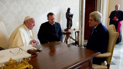 Secretary Kerry sits with Pope Francis and his translator on December 2, 2016, before a one-on-one meeting in the Papal Apartments at the Vatican in Vatican City.