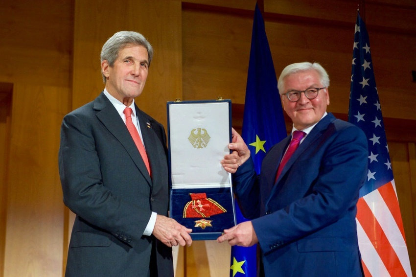Secretary of State John Kerry poses with German Foreign Minister Frank-Walter Steinmeier after receiving the Order of Merit - the higher civilian award in Germany - from German officials during a ceremony at the German Foreign Ministry.