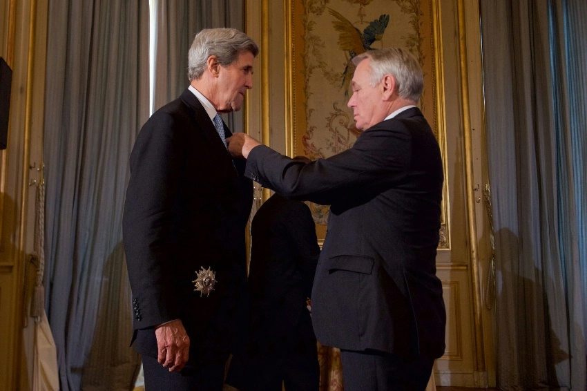 French Foreign Minister Jean-Marc Ayrault presents U.S. Secretary of State John Kerry the Grand Officer of the Legion d'honneur, the second-highest level of the French award, during a ceremony on December 10, 2016.