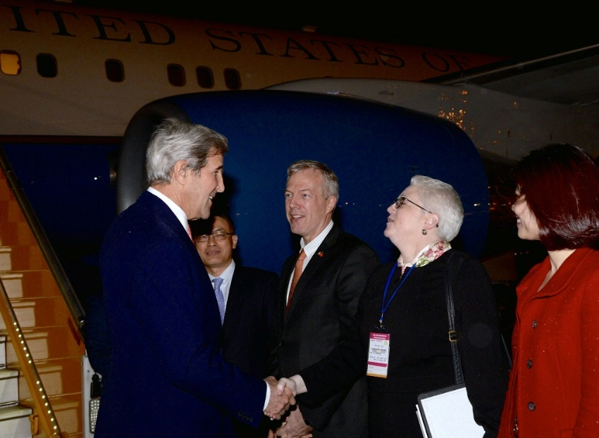 Secretary Kerry Is Greeted by Deputy Chief of Mission Sutton Upon Arrival in Hanoi