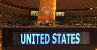 Date: 01/18/2017 Description: DipNote: A placard for the United States' delegation sits atop a table, as Secretary of State John Kerry speaks at the UN General Assembly at the United Nations headquarters in New York.  - State Dept Image